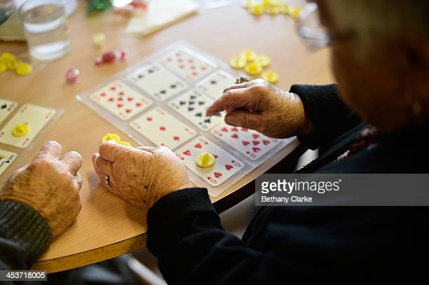 Elderly people enjoy a game of Bingo at the AgeUK Ann Owens Centre on December 4 2013 in Barnet England AgeUK are a nationwide charity organisation...