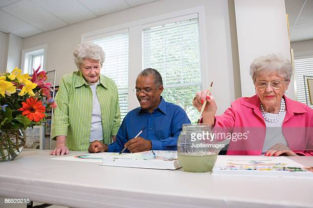 Elderly people painting with watercolors