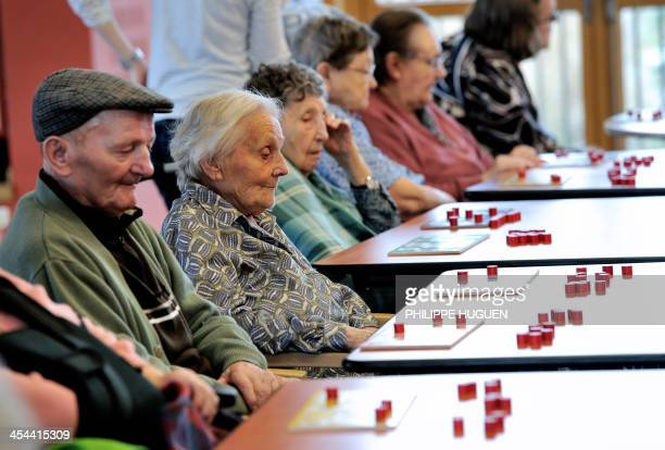 Elderly people play bingo at the Centre Montgre an EHPAD in Lens northern France on December 4 2013 AFP PHOTO / PHILIPPE HUGUEN