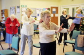 Elderly people take part in a Tai Chi Class at the AgeUK Ann Owens Centre on December 4 2013 in Barnet England AgeUK are a nationwide charity...