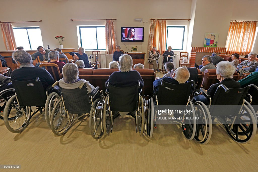 Living Room With Tv And People elderly people watch tv in the living room of nursing home in
