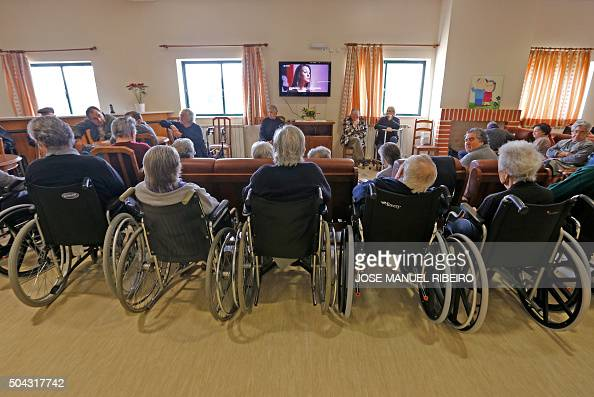 Elderly people watch tv in the living room of nursing home for Living room tv channel 10