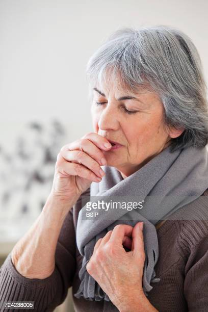 Elderly person coughing