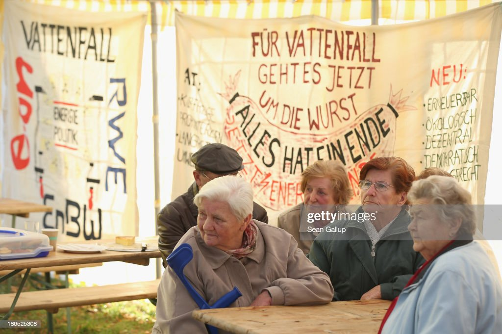 Elderly residents attend a protest against the expansion of open-pit lignite coal mines at the annual village fest on October 31, 2013 in Atterwasch, Germany. According to plans by Swedish energy conglomerate Vattenfall and approved by the Brandenburg state legislature, Atterwasch and at least four other communities are to be raized and their inhabitants compensated and relocated in order to make way for the expansion of the mines. Energy policy and the role of coal is a heated topic at the moment in coalition negotiations between the Social Democrats (SPD) and Christian Democrats (CDU) currently taking place in Berlin.