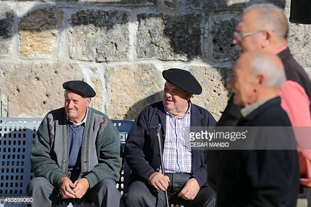 Elderly residents of Spanish village Castrillo Mota de Judios which means 'Castrillo Mound of Jews' sit on a bench in Castrillo Mota de Judios near...