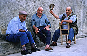 Elderly Sardinian men chatting in the village of Tuili.
