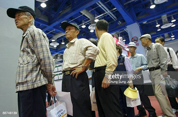 Elderly South Korean job seekers line up for interview during an elderly persons' job fair on September 23 2005 in Seoul South Korea When the...