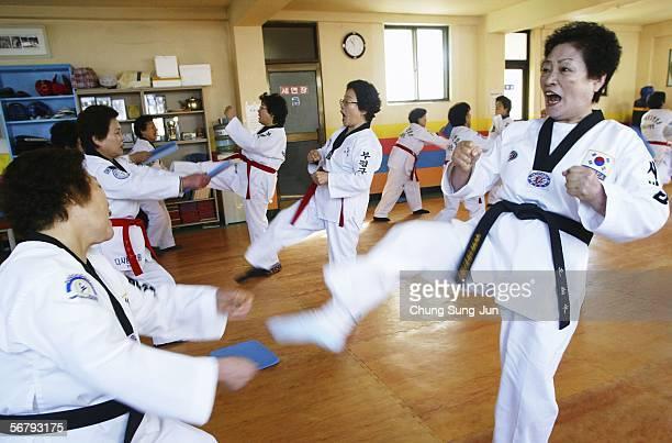 Elderly South Korean women practice TaeKwonDo on February 9 2006 in Incheon South Korea Taekwondo is a modern martial art from Korea that is...