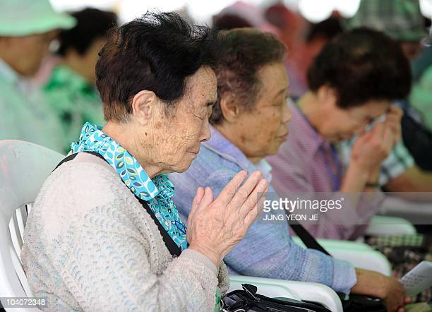 Elderly South Koreans who were separated from their families during the 195053 Korean War pray during a traditional ritual for their deceased...