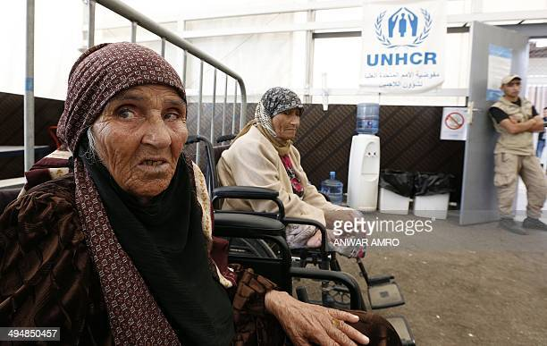 Elderly Syrian refugees sitting in wheelchairs await to be registered at a UNHCR registration center one of many across Lebanon in the northern port...
