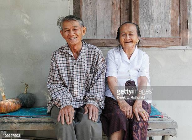 Elderly Thai siblings laughing