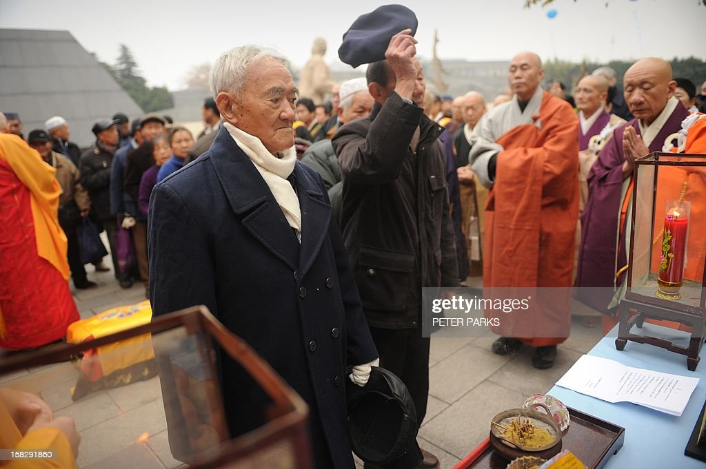 Elderly visitors pay their respects to victims on the 75th anniversary of the Nanjing massacre at the Memorial Museum in Nanjing on December 13, 2012. Air raid sirens sounded in the Chinese city of Nanjing on December 13 as it marked the 75th anniversary of the mass killing and rape committed there by Japanese soldiers -- with the Asian powers' ties at a deep low. AFP PHOTO/Peter PARKS