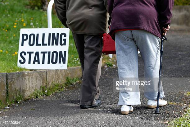 Elderly voters walk from a polling station after casting their votes in the general election in Sheffield UK on Thursday May 7 2015 Britain votes on...