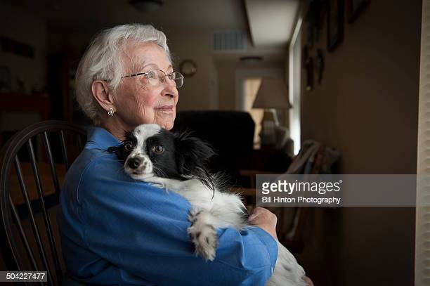 Elderly woman and puppy