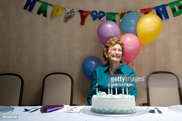 Elderly Woman at Birthday Party With Decorations