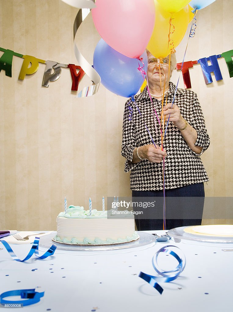 Elderly Woman at Birthday Party With Decorations : Stock Photo
