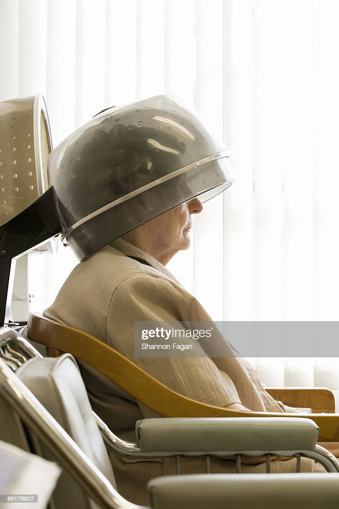 Elderly Woman At Salon With Rollers in Hair : Stock Photo