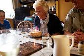 Elderly woman celebrating her birthday