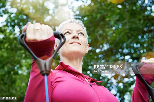 elderly woman doing exercise in park