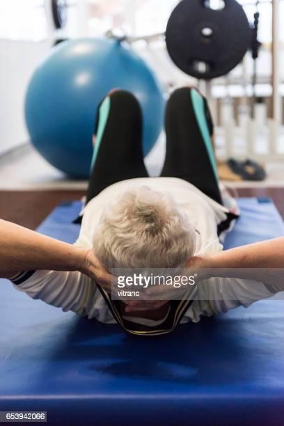 Elderly woman doing relaxation exercises