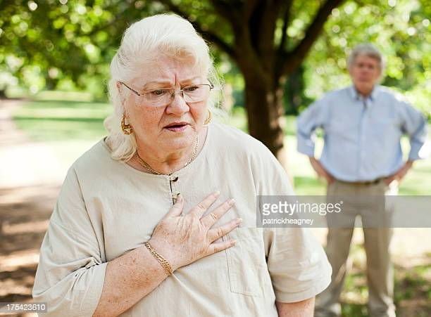 Elderly woman feeling pain in her chest
