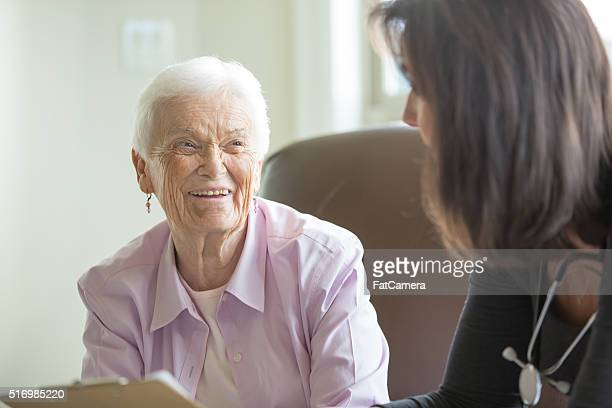Elderly woman getting care in a home like setting