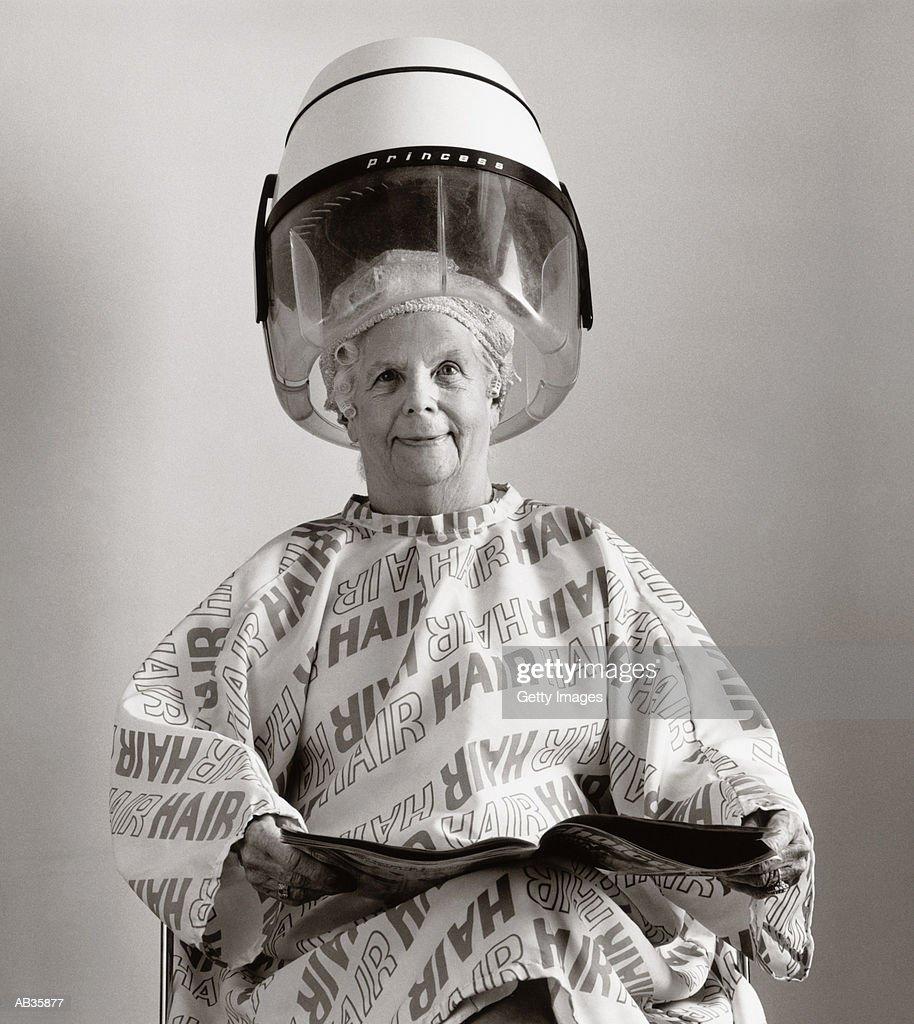 Elderly woman having hair done, (B&W) : Stock Photo