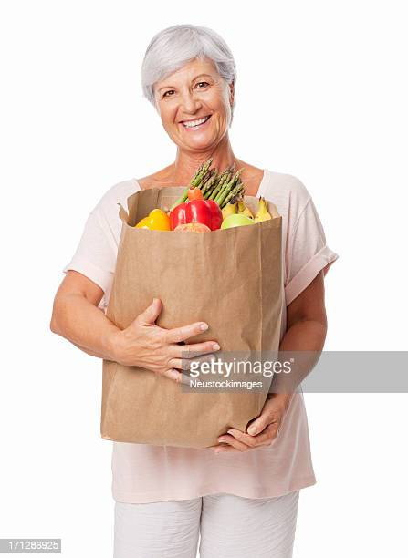 Elderly Woman Holding a Bag Of Groceries - Isolated