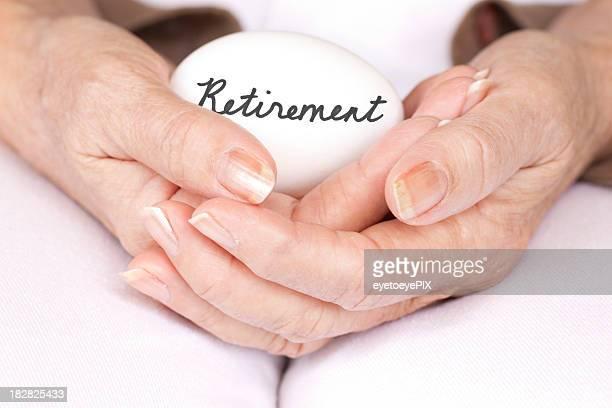 Elderly woman holding retirement egg