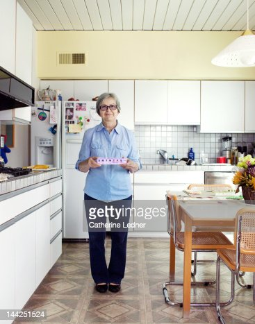 Elderly Woman Holding Weekly Pills : Stock Photo