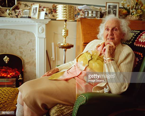 Elderly woman in living room