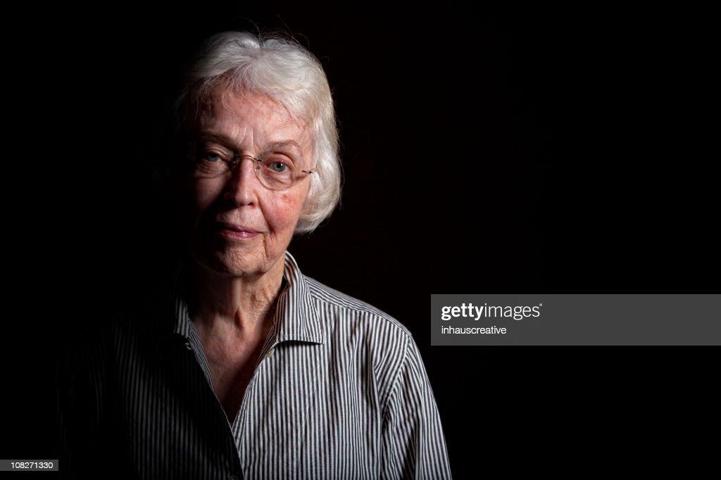 Elderly Woman in the Dark