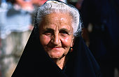 Elderly woman in traditional veil at the S'Ardia festival.