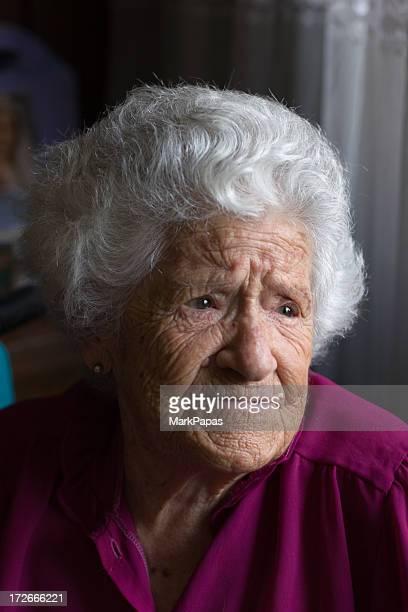 Elderly woman in window light
