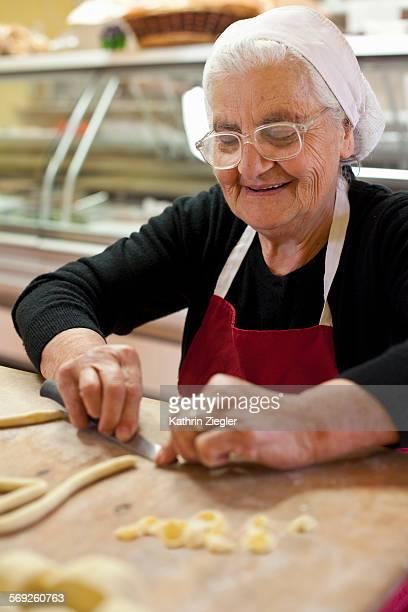 elderly woman making fresh pasta