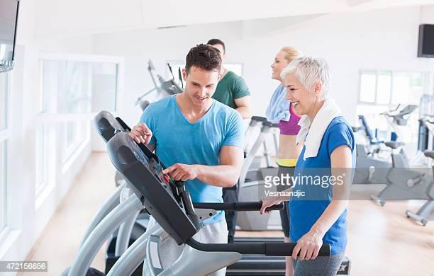Elderly woman on treadmill at gym
