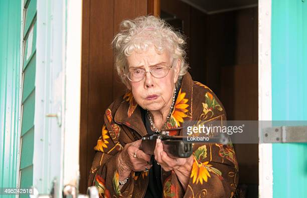 Elderly woman protecting her trailor