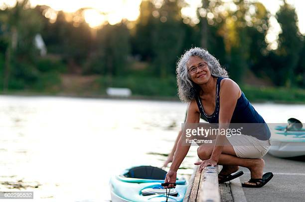 Elderly woman ready to kayak