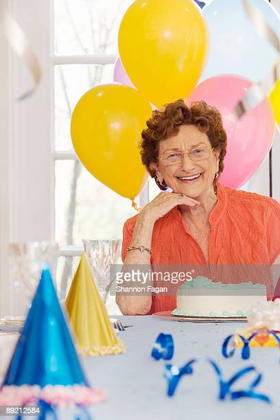 Elderly Woman Smiling at Birthday Party