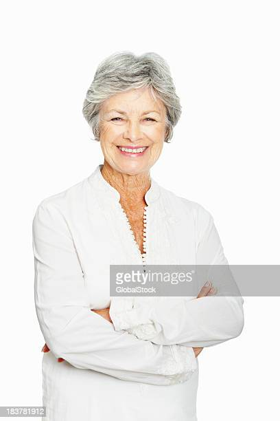 Elderly woman smiling with arms crossed