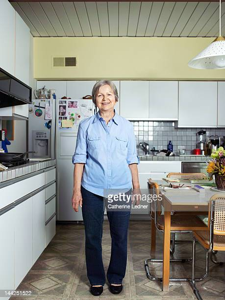 Elderly Woman Standing in Kitchen