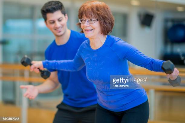 Elderly Woman Stretching with Weights