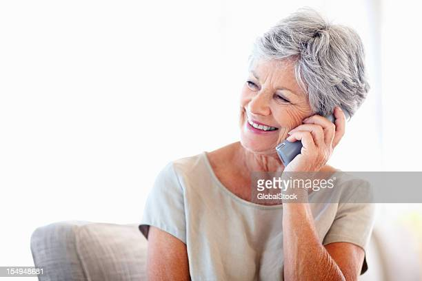 Elderly woman talking on phone