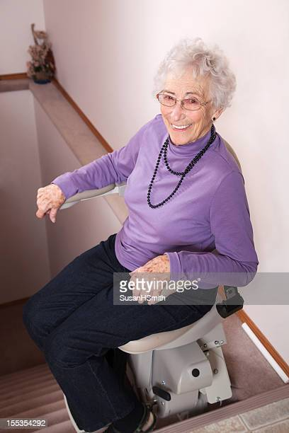 Elderly woman using stairlift: assisted living