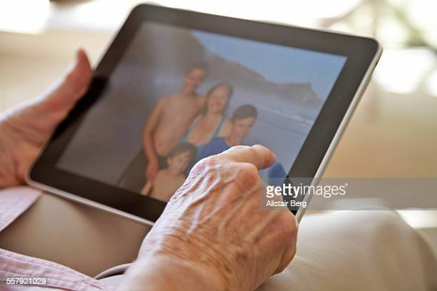 Elderly woman using tablet computer