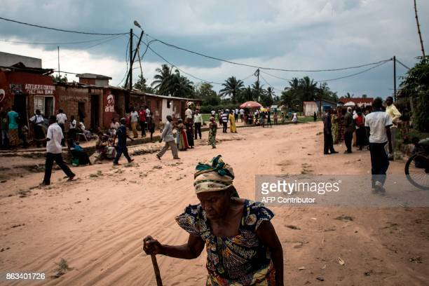 A elderly woman walks down the main road of Nganza on October 19 2017 in Kananga Nganza was the scene of fierce fighting between the local...