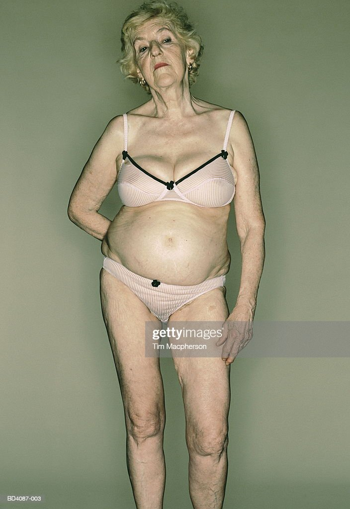 Elderly woman wearing bra and knickers, portrait : Stock Photo