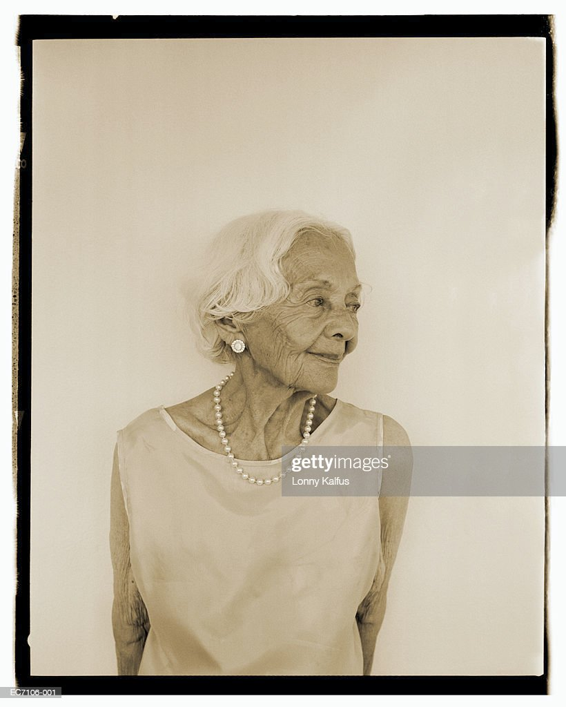 Elderly woman wearing sleeveless dress and pearl necklace (B&W) : Stock Photo