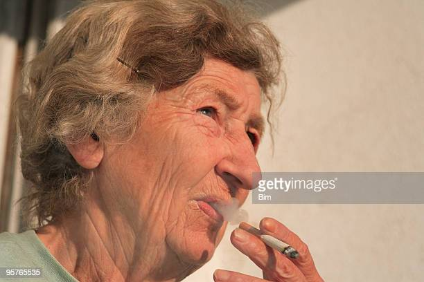 Elderly Woman with Cigarette