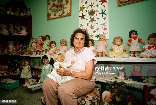 Elderly Woman with Doll Collection